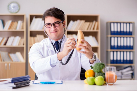 bigstock Doctor in dieting concept with basta01